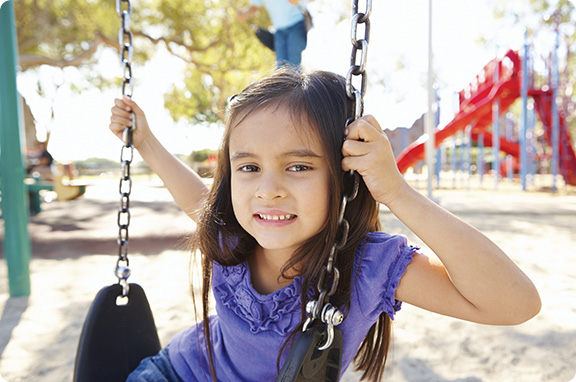 A young girl named Mary sitting on a swing at the YMCA